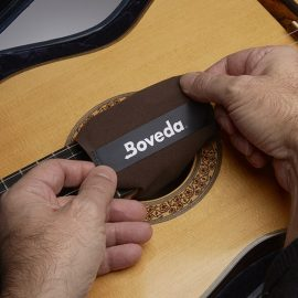Boveda on acoustic guitar