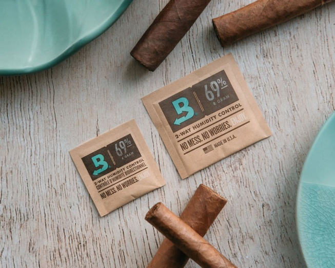 boveda packs surrounded by cigars