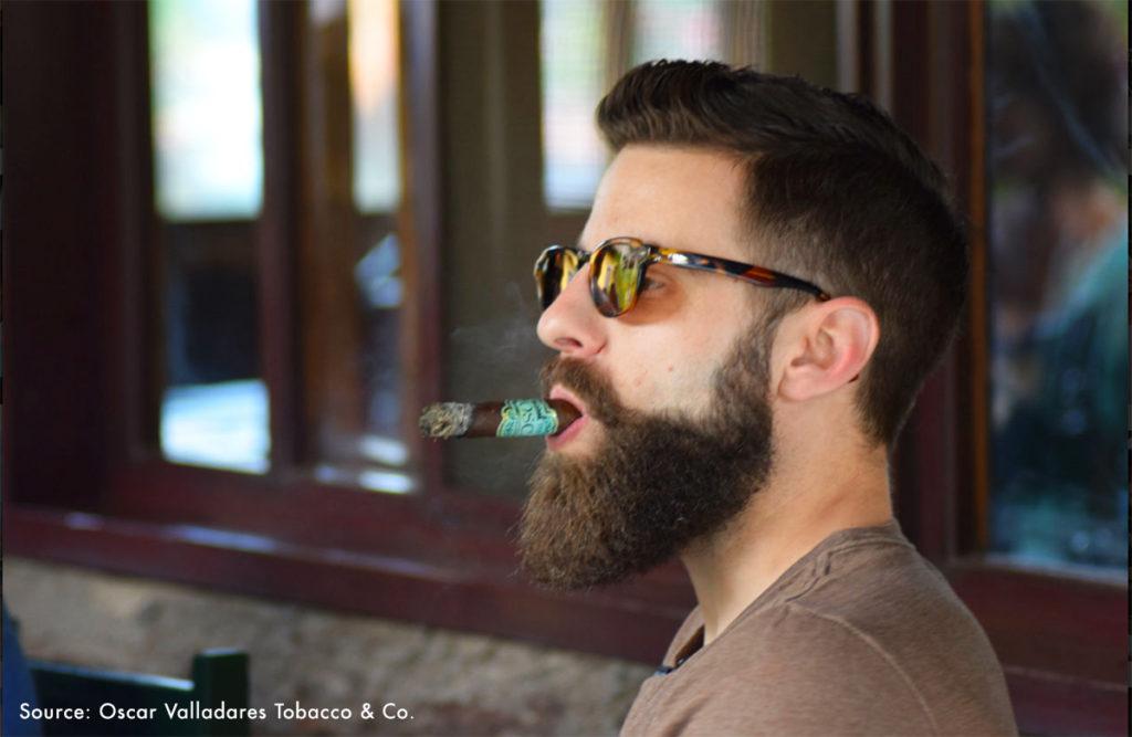 Boveda Box Press podcast host Rob Gagner enjoys an Oscar Habano during a cigar tour of Honduras through Oscar Valladares Tobacco Adventure.